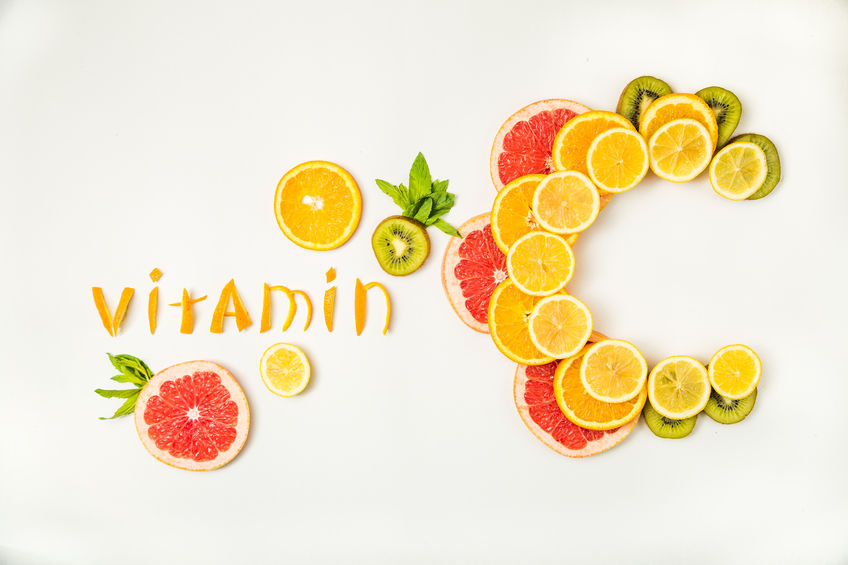 Table with word Vitamin C made with orange slices