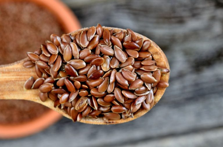 flax seed in spoon on table
