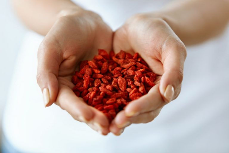 Healthy Organic Diet Food. Woman Hands Full Of Goji Berries