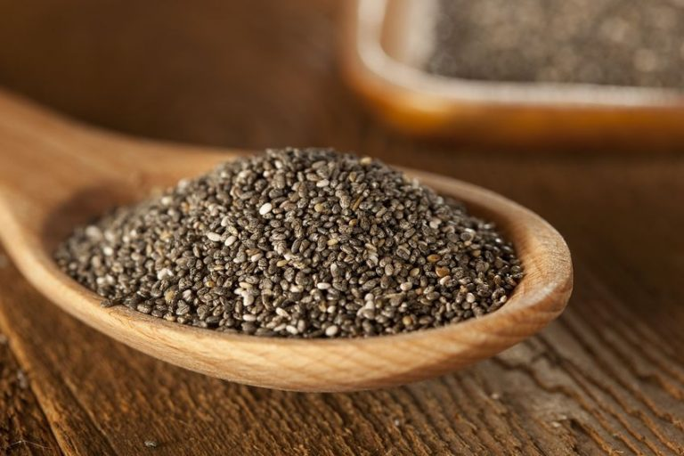 organic dry black and white chia seeds against a background