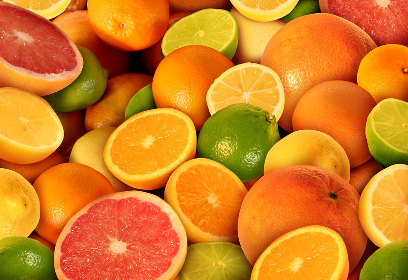 Image with several oranges, some cut in half