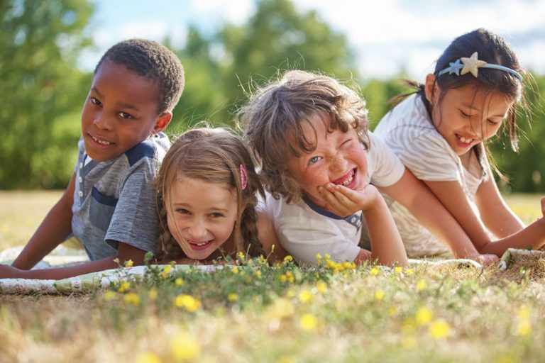 happy kids playing on the grass