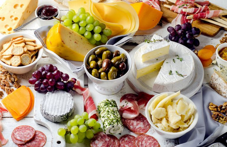 Charcuterie assortment, cheeses, olives and fruits
