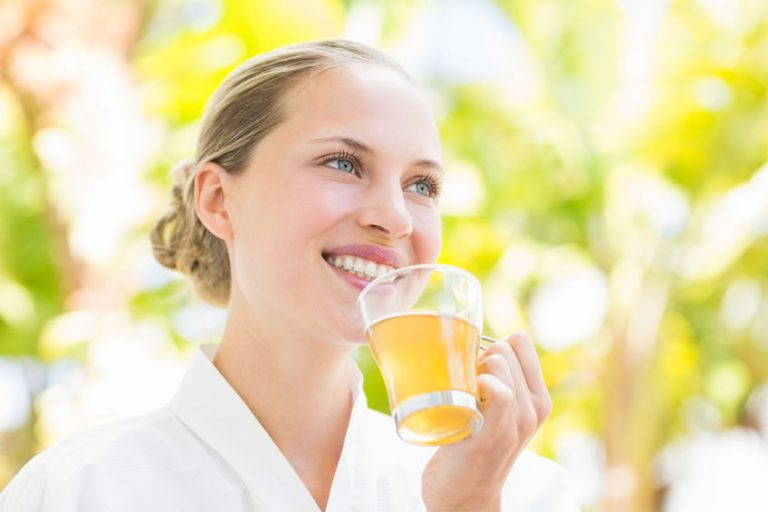 Woman drinking horsetail beverage